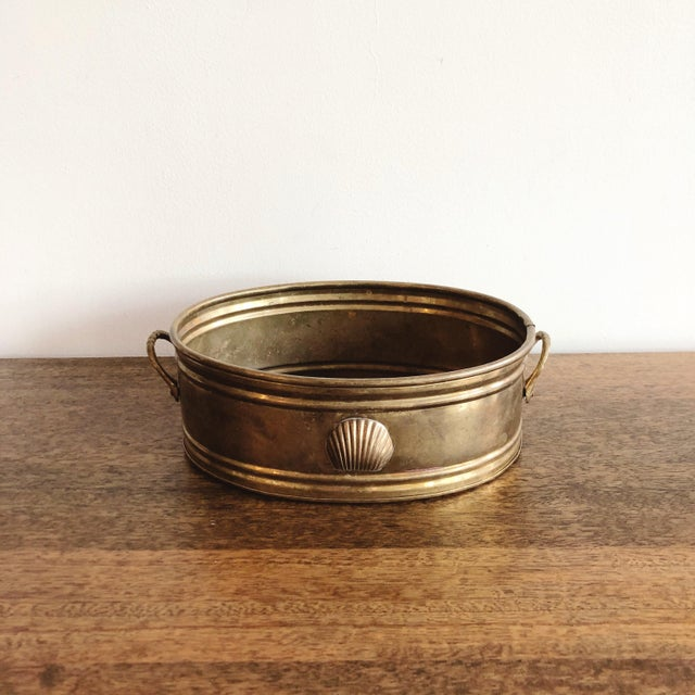 Vintage brass planter with brass seashell detail and handles. Oval shape.
