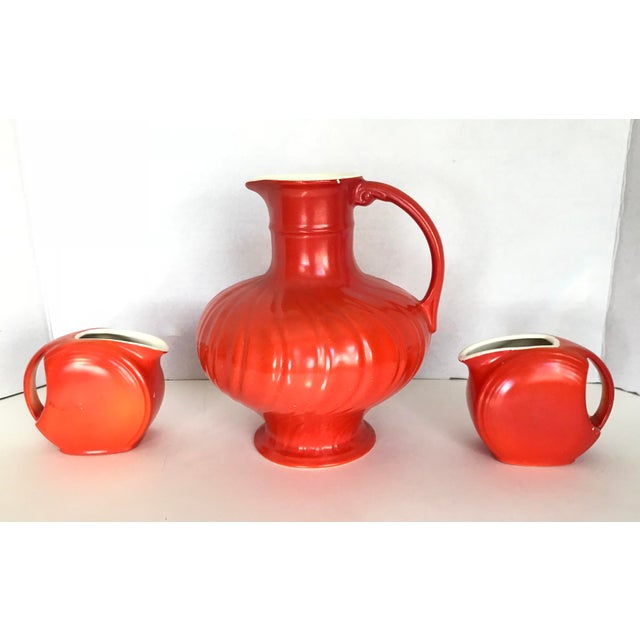 A vibrant and fun set! Pitcher and creamers are in great vintage condition, some minor chips that can be seen in photos....