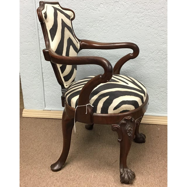 Very unusual substantial carved mahogany armchair upholstered in Ralph Lauren zebra print fabric. The mahogany legs carved...
