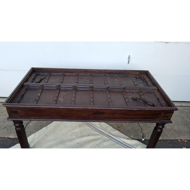 Here we have a 17th Century door converted to a table. The door had been dropped down into a solid wood frame to create a...