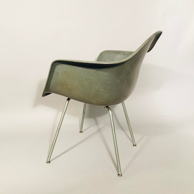 Eames fiberglass molded armchair in elephant hide grey with X-base.