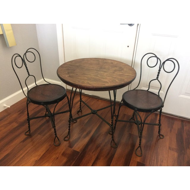 Fabulous vintage metal and wood child's ice cream parlor bistro set! Adorable table and two chairs. Perfect for a child's...