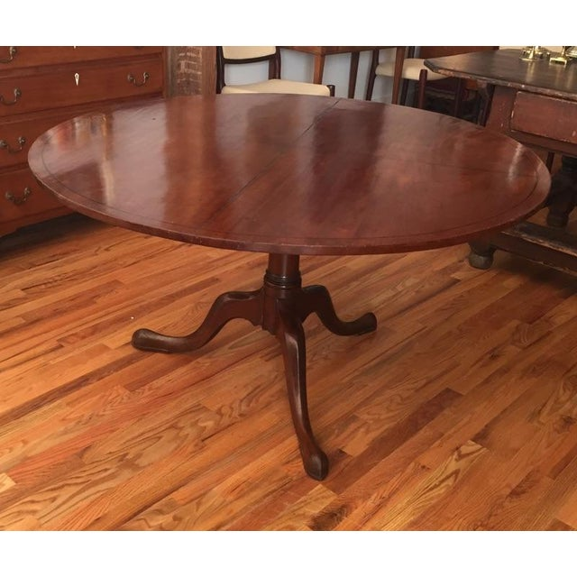 Impressively large mahogany tilt top pedestal base table. Ebony inlay to divide table into quadrants for game playing,...