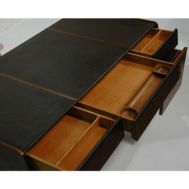 Well designed desk by Bert England for John Widdicomb. The desk has a total of 5 pull out drawers, decorative bronze...