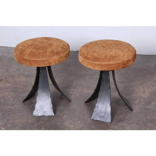 A contemporary pair of beautifully crafted, hand-forged stools with suede cushions. Designed by John Baldasare. These can...