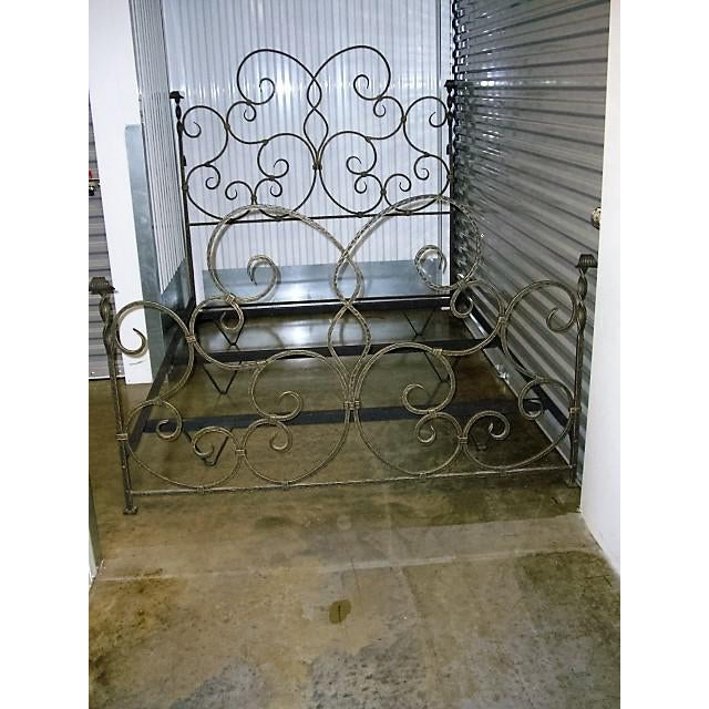 "Wrought iron queen sized bed. Black with a brushed gold antiqued patina. Shipping weight 201lbs. Headboard 60"" in height,..."