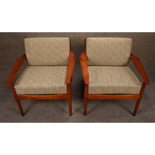 Here is a rare set of two vintage Scandinavian modern easy chairs in teak wood designed by Arne Vodder and manufactured by...