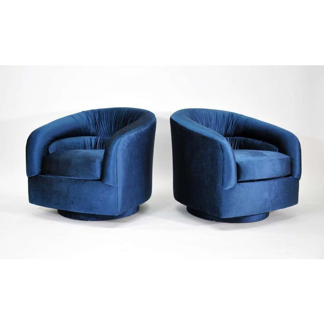 A fabulous pair of Mid-Century Modern barrel back swiveling club chairs, designed by Milo Baughman for Thayer Coggin,...