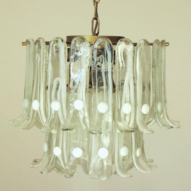 Vintage Italian chandelier with pale green Murano glass petals hand blown with diffused white details and split ends,...