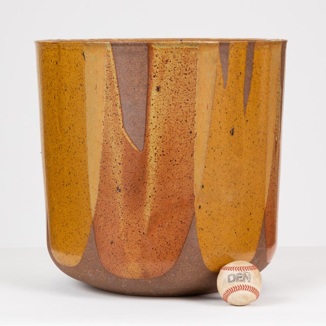 """Malcolm Leland's tulip-shaped LT-24 planter for Architectural Pottery with the Pro/Artisan """"Flame Glaze."""" This planter has..."""