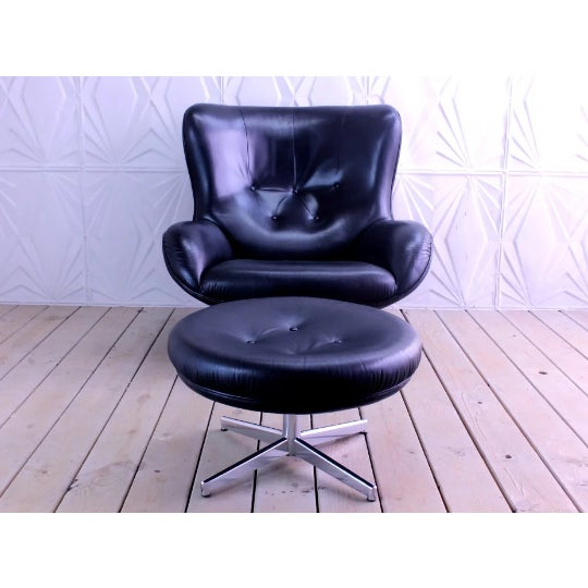 """Very cool and comfy mid century modern lounge chair and ottoman designed by Illum Wikkelso for Michael Laursen. Model """"ML..."""