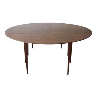 1960s Edward Wormley for Dunbar Walnut Oval Drop Leaf Dining Table For Sale