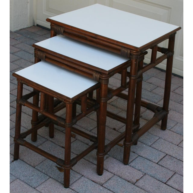 his is a set of 3 rectangular bamboo and rattan nesting tables from the 1950's. They are quality hand crafted with dark...