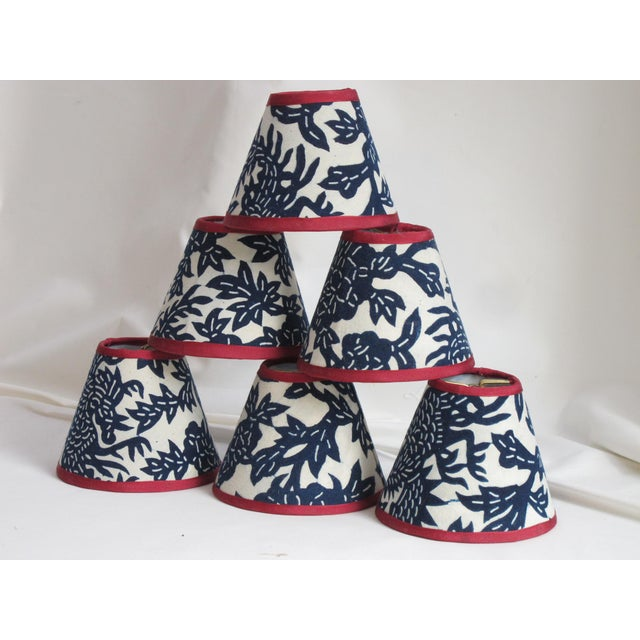 "Hand crafted mini shades from a vintage batik textile in indigo blue and white, will clip onto a chandelier bulb. top 2.5""..."