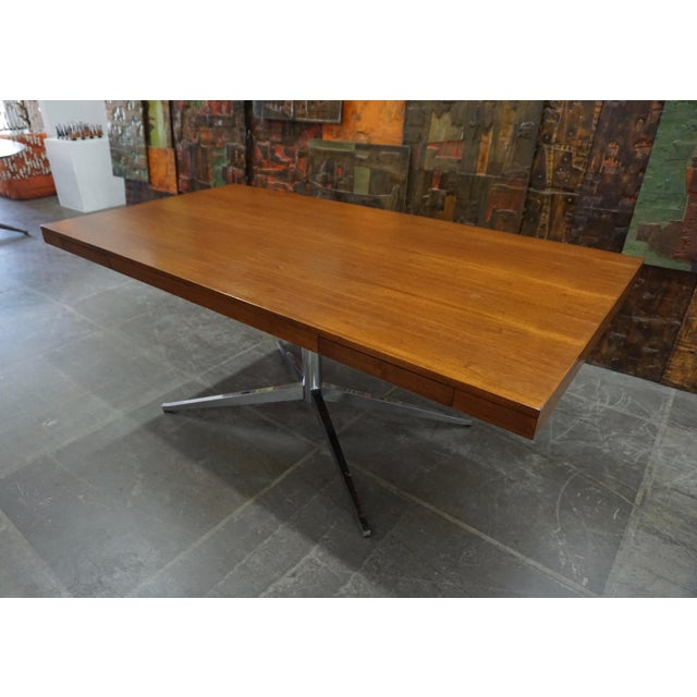 Florence Knoll Partners desk with 2 pullout drawers on 1 side. Walnut veneered with chromed steel base.