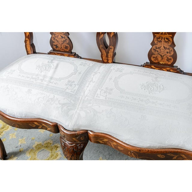 Lovely Dutch white upholstered settee with marquetry.