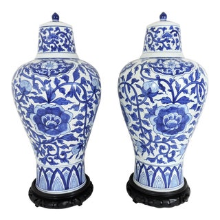 Vintage Chinese Blue and White Flower Vases/Urns With Carved Wood Stands - a Pair For Sale