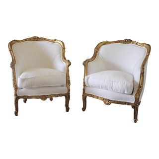 20th Century Giltwood Carved Bergere Chairs in White Belgian Linen - A Pair