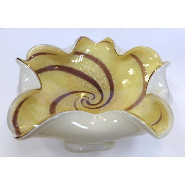 A large Mid-Century Modern Murano cased glass floriform bowl with vanilla and chocolate swirls with what appears to be...