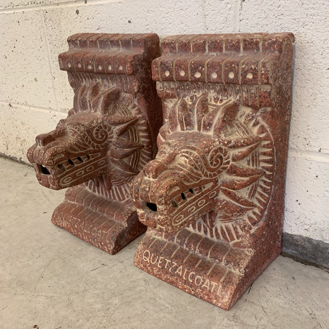 Very cool and large terra-cotta bookends signed INAH Mexico. The Quetzalcoatl pyramid is decorated with the feathered...