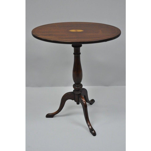 Antique Mahogany Pinwheel Inlay Oval Tilt Top Side Table Details: Central pinwheel inlay, Queen Anne tripod pedestal base,...