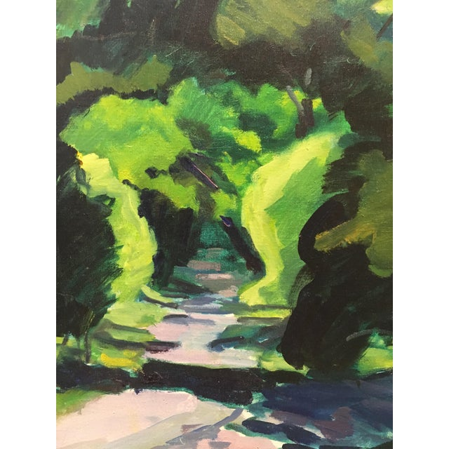 "Framed oil painting by Julia Kelly depicting a lush green landscape, signed J Kelly '73. Painting measures 24""H x 18""W..."
