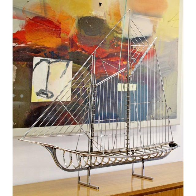 For your consideration is an incredible, chrome, table sculpture of a sailboat, signed and copy-written by Curtis Jere,...