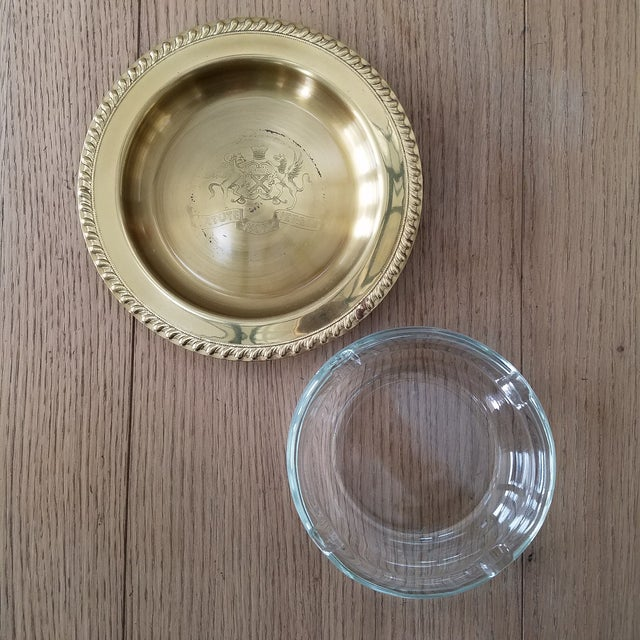 A special find! Vintage glass ashtray with the tray being constructed of brass plating over copper and is etched with coat...
