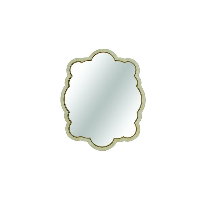 The eclectic cloud shaped Rita Mirror has a curvy frame inlaid with faux white horn and trimmed in gilded antique gold for...