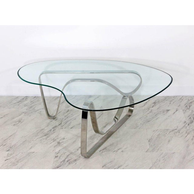 For your consideration is a unique and luxe looking coffee table, with a sculptural asymmetrical chrome base and kidney...