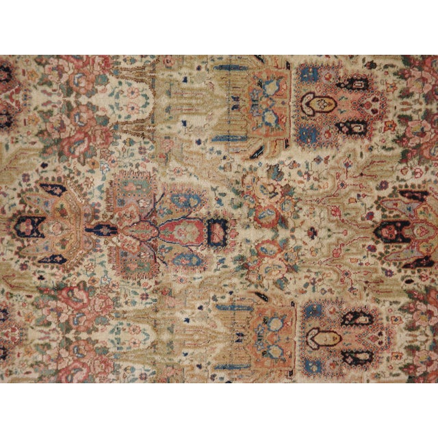 A hand-woven early-20th century Persian Tabriz carpet. It has been professionally washed.