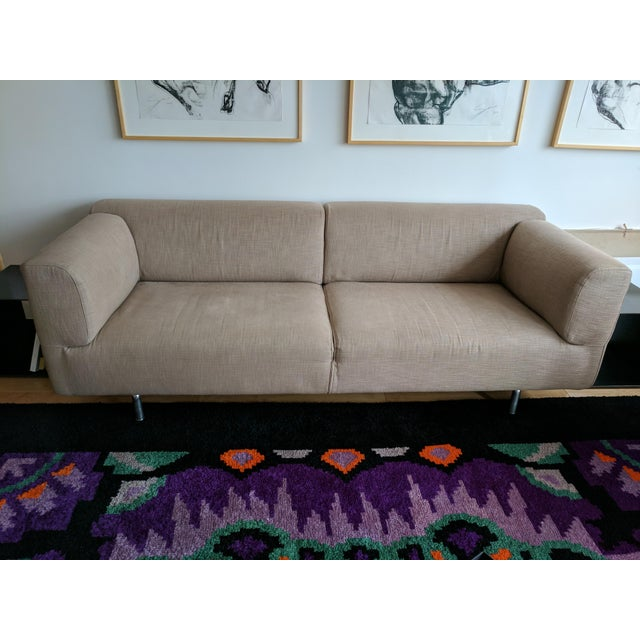 Designed by Piero Lissoni, the Met sofa is in beige Visir fabric (13L231) and makes it the perfect choice for living...