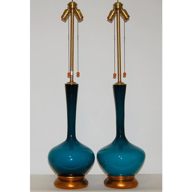 A vintage matched pair of PEACOCK BLUE Marbro table lamps, handblown in Sweden over 50 years ago. There is a moody quality...