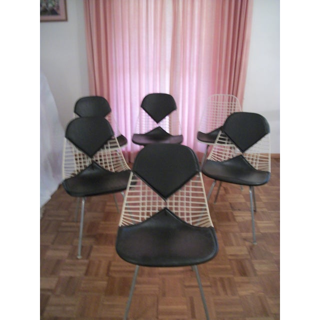 Set of 6 Mid Century original and unrestored Eames for Herman Miller White Wire chairs with Black Bikini pads on H-Bases....