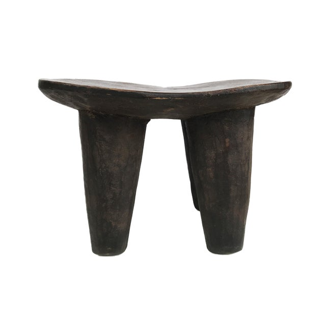 Superb old African Senufo milk stool on four tapered legs with an abstract form . Carved from one piece of wood. Senufo...
