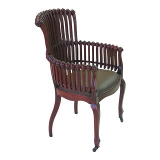 An iconic American aesthetic movement oak 'lollipop' arm chair by George Hunzinger (1835-1898)
