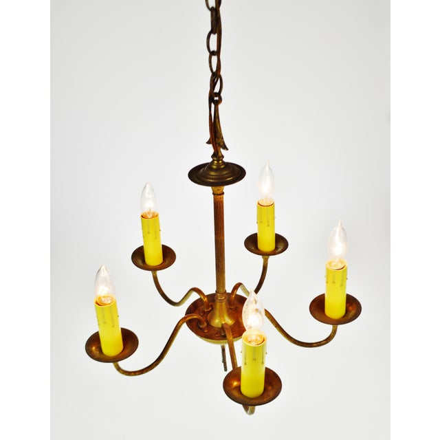 Antique Brass 5 Light Candle Chandelier Arrow Design Condition consistent with age and history. Rewiring recommended....