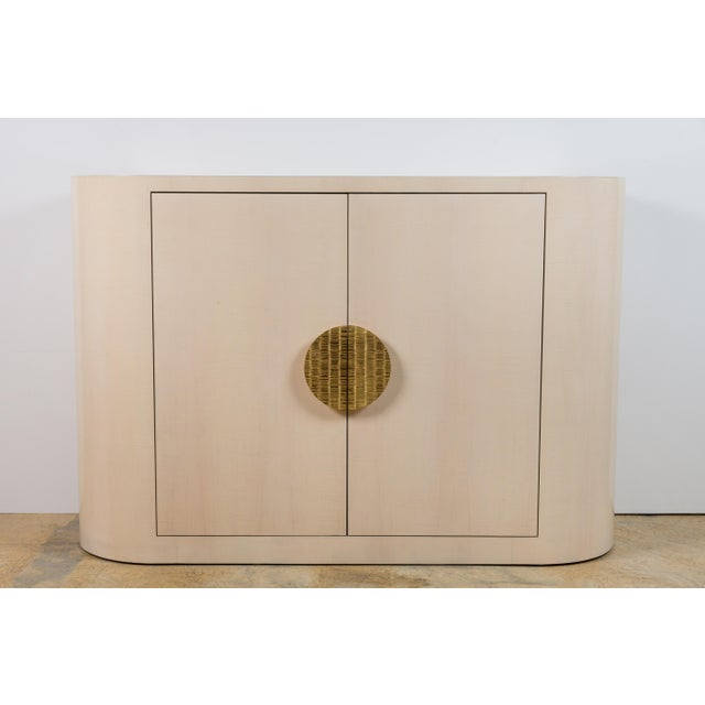 Paul Marra Italian-Inspired 1970s Style Rounded Cabinet. Shown in bleached maple and custom brass handles.