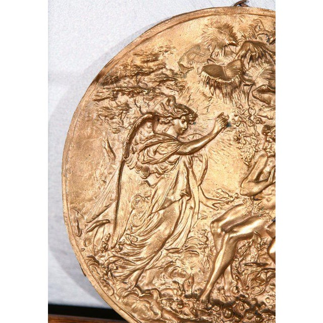 A good plaque, in bronze, thought to be American and circa 1900. Adam and Eve are portrayed receiving guidance in the...
