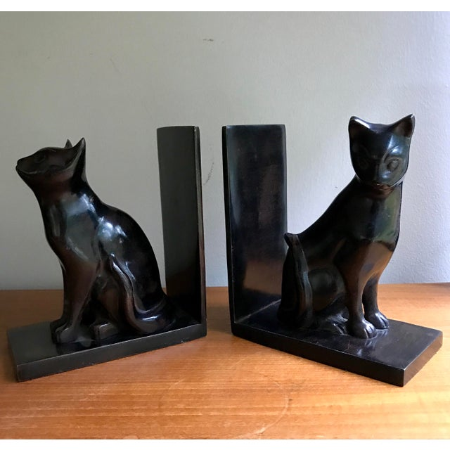 Treat your books to some feline power with this set of polished metal cat bookends. Smooth to the touch, dark brown/black...