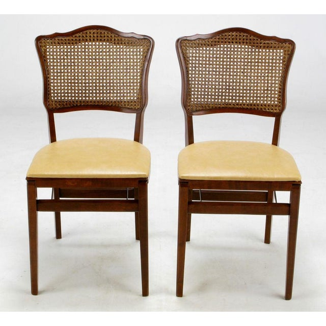 Unusual and rare set of Regency style folding dining chairs in mahogany and cane, with dark ivory leather seats and...
