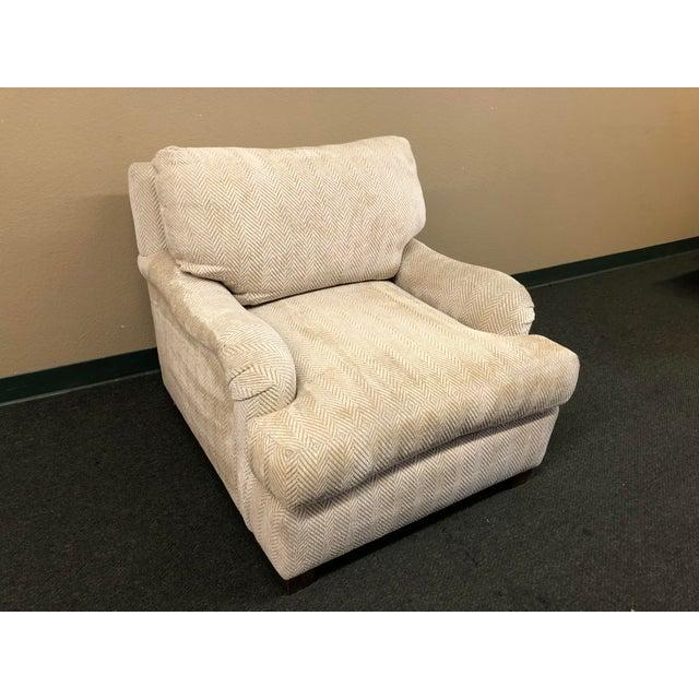 Design Plus Gallery presents a custom arm chair. The down back cushion, down wrapped seat cushion and lumbar cushion...