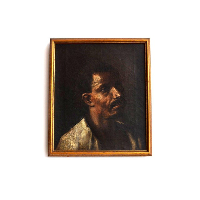 Vintage oil painting of a man's face. Gold frame.