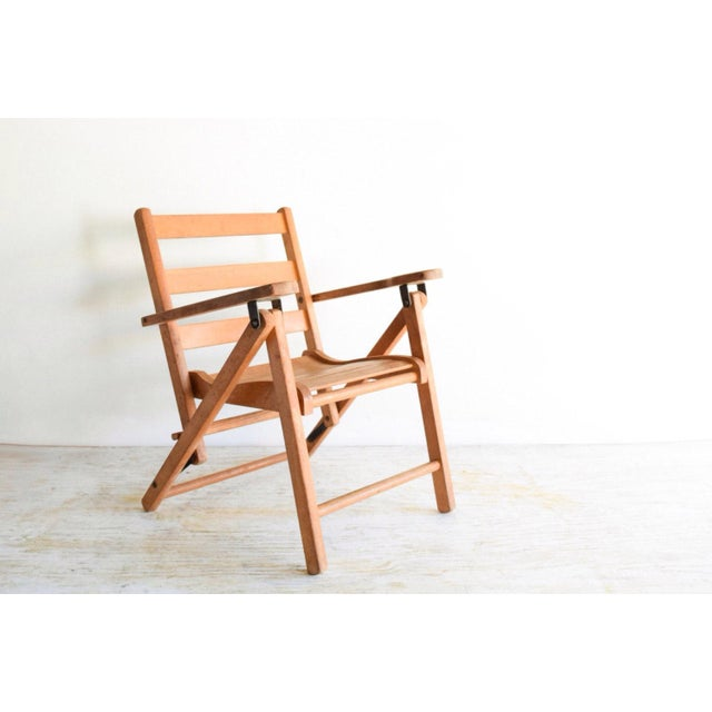 • Adorable little vintage child's wooden folding deck or lawn style chair. • Well constructed and designed with a curved...