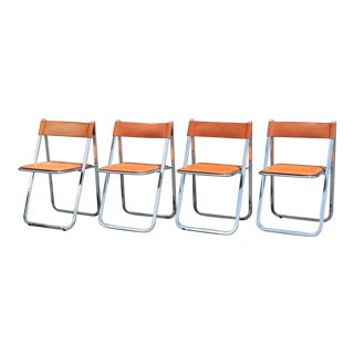 Mid Century Italian Modernist Chrome with Orange Leather Folding Dining Chairs - Set of 4 For Sale