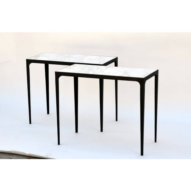 Pair of 'Esquisse' wrought iron and honed marble side tables in the style of Jean-Michel Frank.