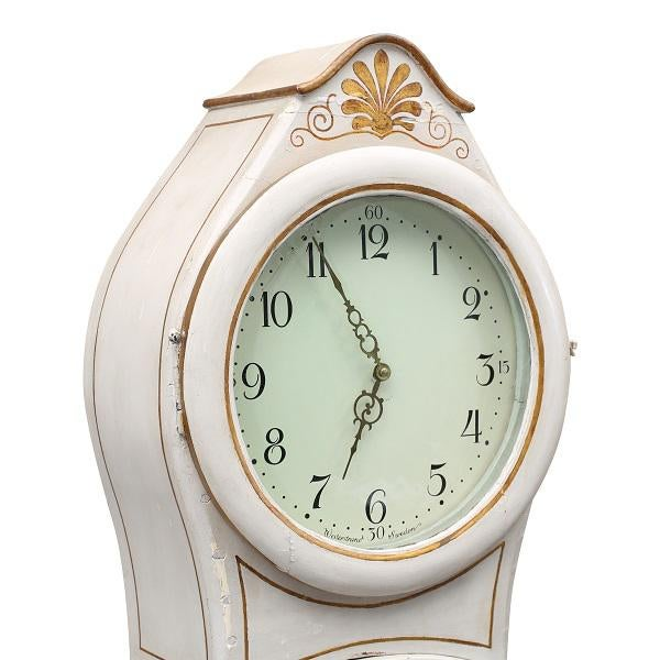 Antique Swedish Mora clock with carved detailing to crown Additional subtle painted detail to the body This clocks...
