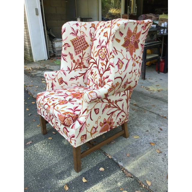 Fabulous English armchair upholstered in a gorgeous cotton and wool crewel fabric. In exquisite shades of red, tangerine,...