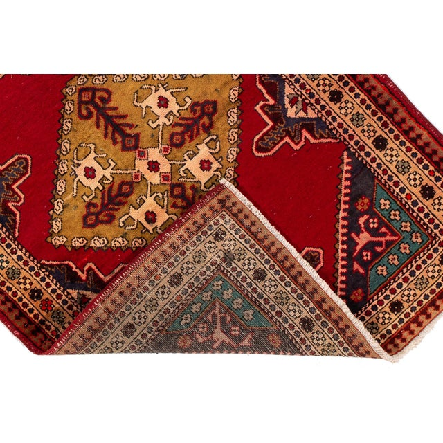 A hand-knotted vintage Persian Hamadan rug with a geometric design. This piece has great detailing and colors. It would be...