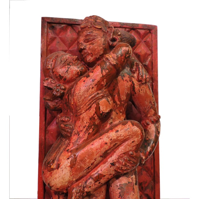 Luciano Tempo reproduction of Kama Sutra erotic wood wall carving. Here red and orange paint make for a visceral take on...